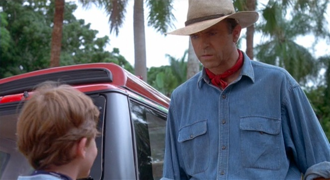 The inches between Sam Neill's actual shoulders and the shoulder seams of Dr. Grant's shirt indicate the shirt's excessive size.