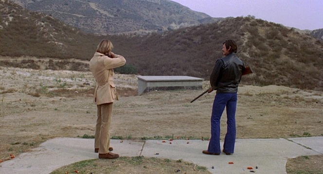 Steve's safari-influenced clothing is trendy for the 1970s, but Arthur's racer jacket and jeans—despite the latter's '70s flare—is arguably the more timeless ensemble.