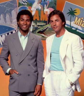 Another promotional photo of Philip Michael Thomas and Don Johnson against a touristy backdrop leaning into the Miami setting.
