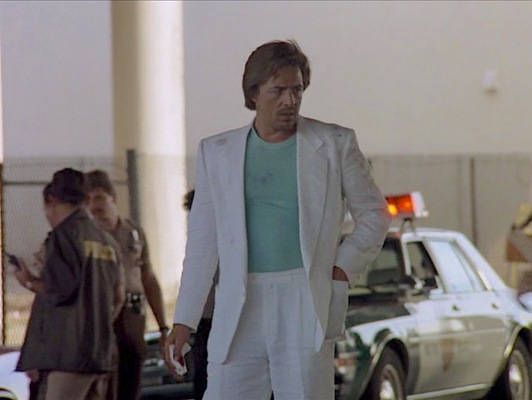 The whiteness of Crockett's linen suit makes dirt and scuff even more noticeable after Crockett dives to the ground during a car bombing.
