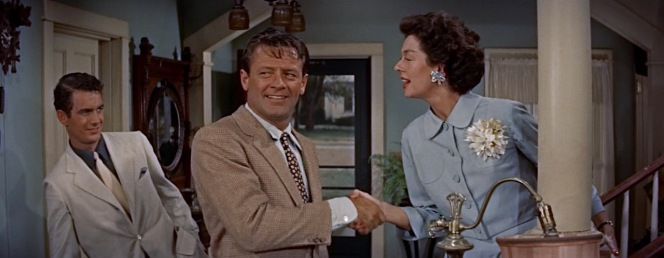 If only Hal had kept his sports coat on, he may have out-dressed Benson, whose take on the stereotypical movie gangster would likely have been out of place for a small town picnic in rural Kansas.