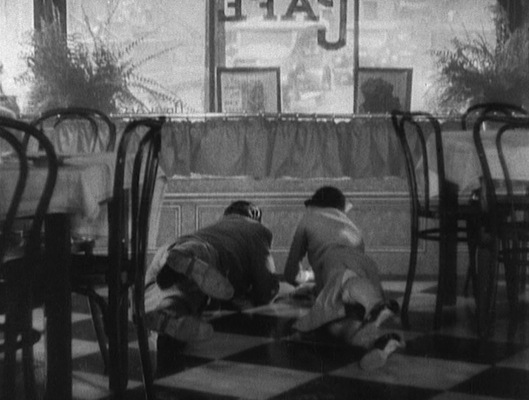 Tony and Poppy duck to safety when the restaurant comes under fire, a loose depiction of the real-life incident in September 1926 when Hymie Weiss sent eight cars full of gunmen to fire 1,000 rounds into Al Capone's then-headquarters at the Hawthorne Hotel in Cicero.
