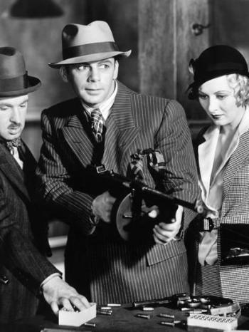 Paul Muni, flanked by Vince Barnett and Karen Morley, in Scarface (1932)