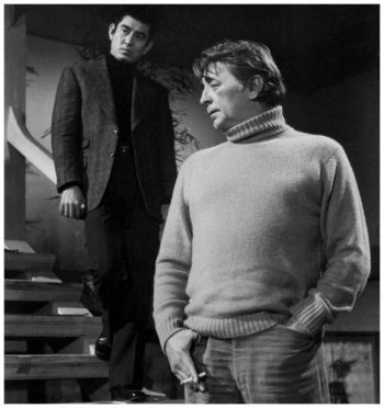 Production photo of Ken Takakura and Robert Mitchum in The Yakuza.