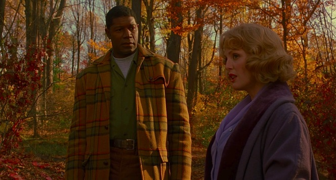 "Raymond's colorful jacket blends against the autumnal leaves, communicating both his earthiness and that the two are sharing their last moments of relative peace while his association with Cathy is still ""unseen"" to much of her social world."