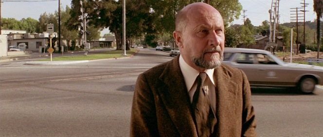 Dr. Loomis just misses the sight of his stolen station wagon... and the recently escaped Michael Myers behind the wheel.