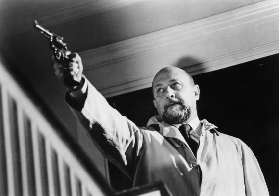 Production photo of Donald Pleasence as Dr. Sam Loomis in Halloween, aiming his Smith & Wesson Model 15 at Michael Myers.
