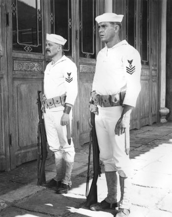"Frenchy (Richard Attenborough) and Jake Holman (Steve McQueen) stand attention in their ""undress whites"" with M1903 Springfield rifles when ashore in The Sand Pebbles."