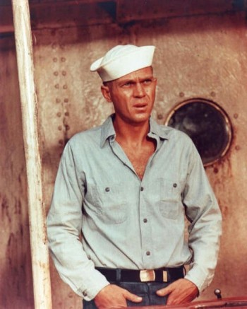 Steve McQueen in The Sand Pebbles, sporting a light chambray work shirt and contrasting dark dungarees.