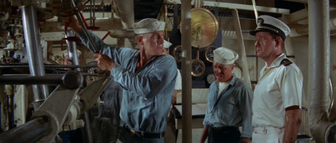 Despite his mastery of the engine room, Holman finds himself in yet another confrontation with Lieutenant Collins. Note the lighter wash of his dungarees which have little contrast with the color of his shirt in this sequence.