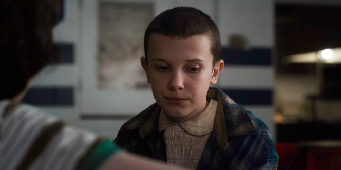 "Eleven, clad in Hop's flannel in ""The Upside Down"" (Episode 1.08, referring to the episode title not the location). It would be a welcome added layer as she finds herself hiding in the woods for weeks after the incident at Hawkins Middle School."