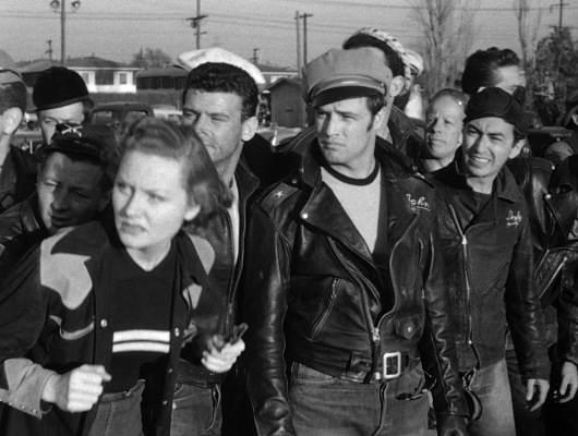 Johnny and his pals watch the Carbondale motorcycle races before deciding that their leader is worthy of at least winning the second place prize.