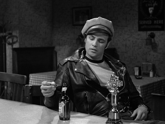 Johnny eschews the glass that Kathie provided for his beer, choosing to drink his Blatz straight from the bottle.