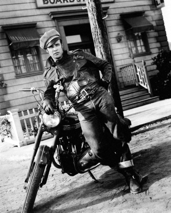 Marlon Brando leans against his character's trademark Triumph in The Wild One (1953)