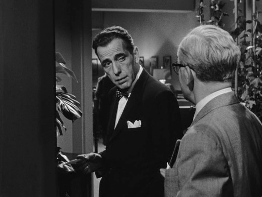 Dix Steele at the beginning of In a Lonely Place, down on his luck but not without sarcastic swagger.
