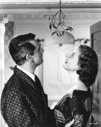 Cary Grant and Ingrid Bergman seek to further their indiscretion under the mistletoe.