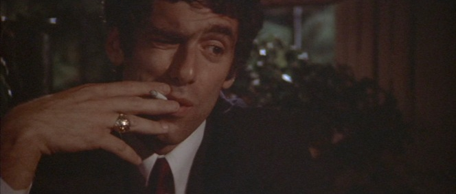"Rather than try to ape the distinctive smoking style of his predecessor Humphrey Bogart, Elliott Gould develops a unique ""smoking face"" for his take on Philip Marlowe."