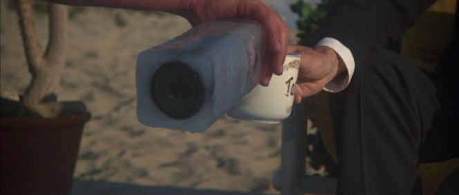 Roger Wade refills Marlowe's mug of aquavit.