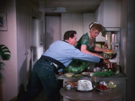 Nicky helps himself to a sample of Tacy's long-awaited home-cooked dinner.