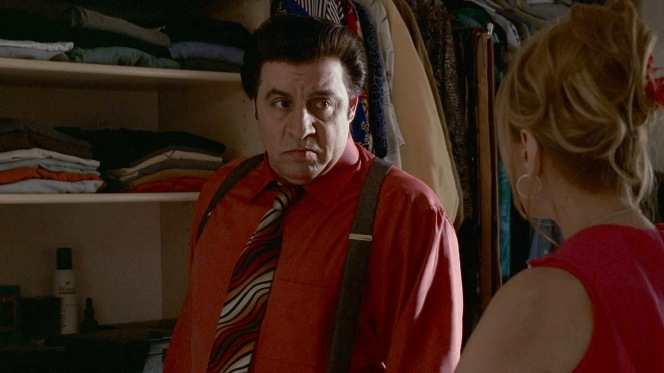Silvio stands among his enviably varied closet.