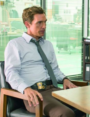 "Production photo of Matthew McConaughey sporting Rust Cohle's pale blue shirt and loosened striped tie, both made by Anto, in ""Seeing Things"" (Episode 1.02)"