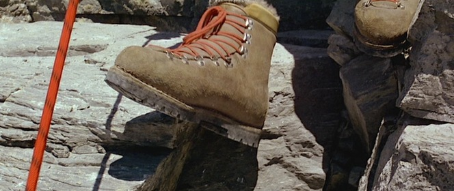 Hemlock's brown leather double boots with removable lining and red laces on a D-ring and speed hook system were typical of the era and particularly suitable for climbing with their Vibram soles.