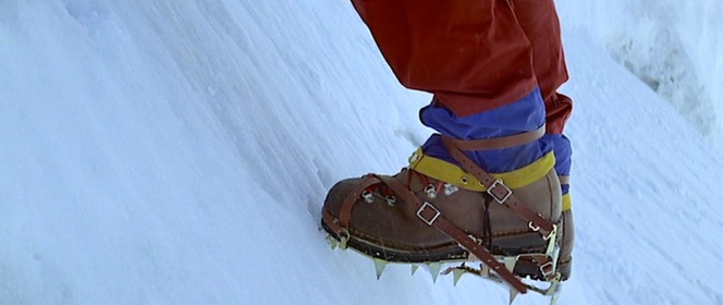 Hemlock's crampons are essential for climbing the icy mountainside.