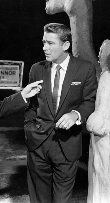 Peter Lawford as Jimmy Foster in Ocean's Eleven (1960)