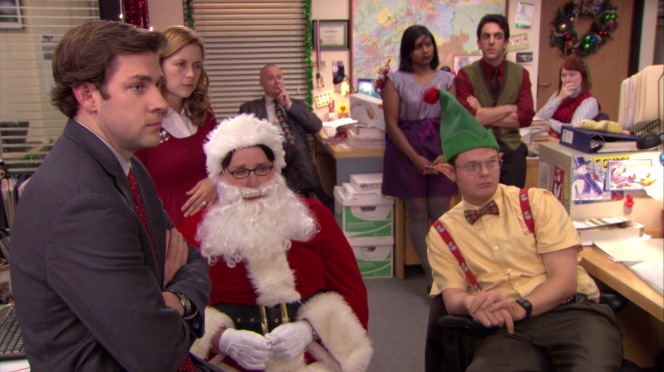 "Tidings are all but good when Michael's ""Hurt, Petulant Jesus"" goes too far roasting Phyllis in ""Secret Santa"" (Episode 6.13). Left to right: John Krasinski as Jim Halpert, Jenna Fischer as Pam Beesly, Phyllis Smith as Phyllis Lapin (as Santa), Creed Bratton, Mindy Kaling as Kelly Kapoor, Rainn Wilson as Dwight Schrute, B.J. Novak as Ryan Howard, and Kate Flannery as Meredith Palmer."