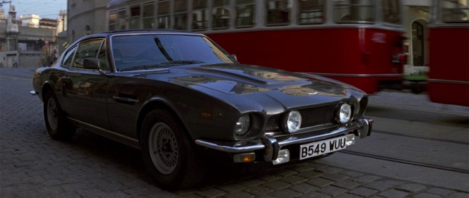 Bond's parked Aston Martin V8 on the streets of Bratislava.