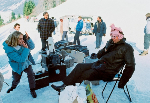 More behind-the-scenes fun with d'Abo and Dalton as she snaps a photo of Bond keeping warm with a cigarette and a pink scarf wrapped around his head. (Source: Thunderballs)