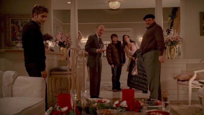 The family watches as Hector excitedly runs toward the Christmas tree.