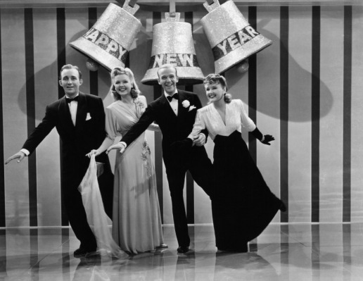 Bing Crosby, Marjorie Reynolds, Fred Astaire, and Virginia Dale ring in the new year in <em>Holiday Inn</em> (1942).