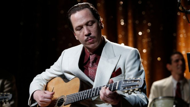 Production photo of Reda Kateb as Django Reinhardt.