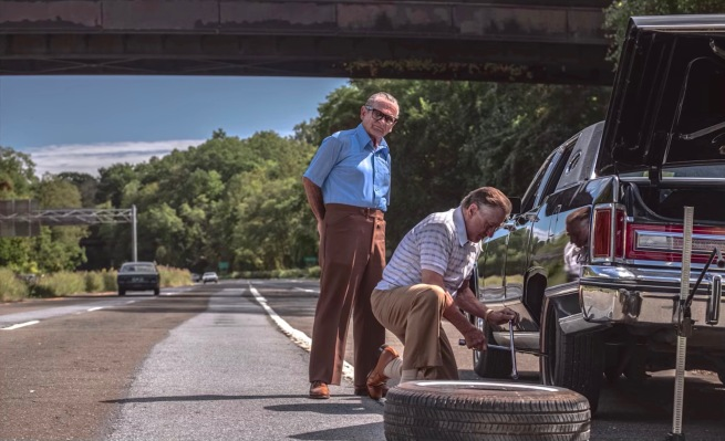 Production still of Joe Pesci as Russell Bufalino overseeing Frank Sheeran's (Robert De Niro) effort to change a flat tire on his Lincoln.