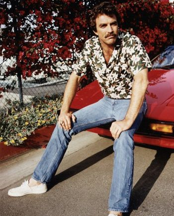 Tom Selleck as Thomas Magnum in a promotional shot for Magnum, P.I. Evidently, the showrunners had not yet chosen Magnum's watch of choice.