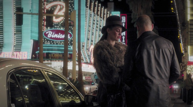 Catty-corner from Binion's, Holly splits her share of Danny's 50 grand with Nick. The Western-like yoke and details of Nick's leather jacket are fitting with the old-school country vibe promoted by Binion's.