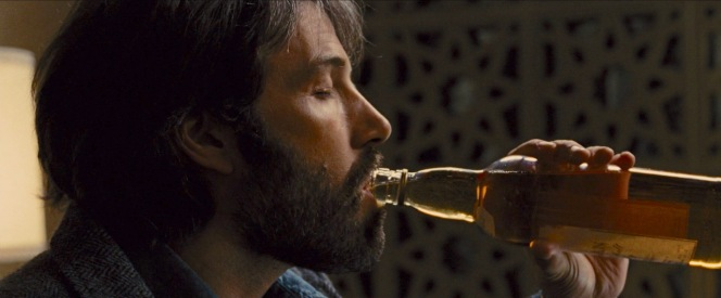 "The Macallan bottle in Argo appears to have a period-correct logo that doesn't reflect the whisky's age, instead following the word ""MACALLAN"" with the scripted words ""Pure Highland Malt Scotch Whisky""."