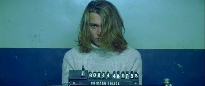 Something tells me George would have to sweep that hair out of his face for the CPD to have a truly effective mugshot in their records.