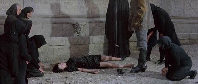 "Zeno approaches one of Eleana's ""girls"", tragically executed by the Nazis as a reprisal against the resistance efforts."