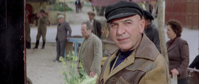 What better way to establish a character as a Greek fisherman than to dress him in a Greek fisherman's cap?
