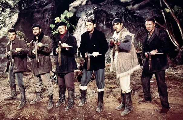 The sextet poses with their Sten guns.
