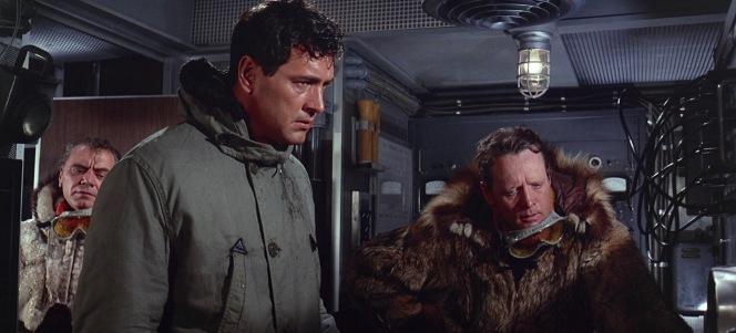 Vaslov, Ferraday, and Jones consider their next step upon breaking through the ice.