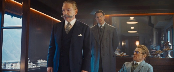 Backed by his friend Bouc, Poirot shares news of Ratchett's murder with the assembly of stranded passengers including the Norfolk jacketed Hardman (Willem Dafoe) to his left.