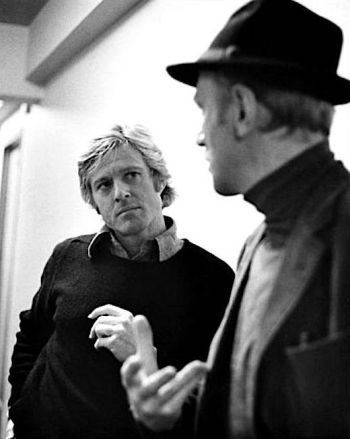 Behind the scenes, Robert Redford and Max von Sydow call a truce from their characters' deadly game of cat-and-mouse.