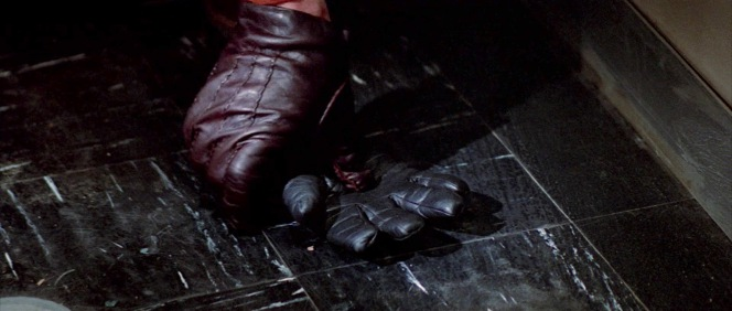 "Joubert breaks the ice with Condor when he steadily bends down and, with his already gloved hand, picks up an errant black glove from the floor of the elevator they share. ""Yours?"" he asks, before delicately placing the glove on the handrai."