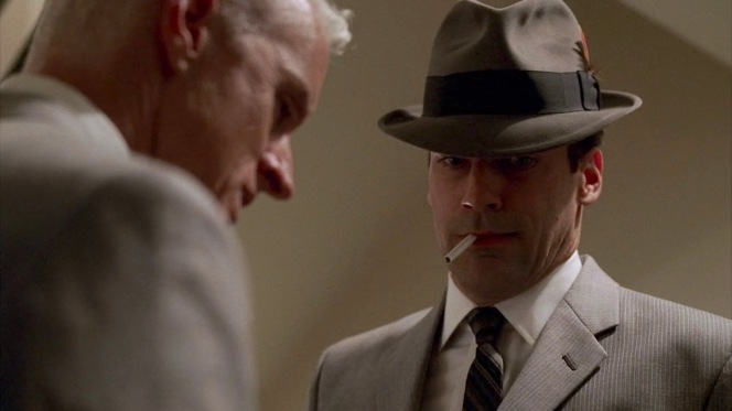 "Wearing his hat rather than carrying it in ""Red in the Face"" (Episode 1.07), Don shows off his healthier respiratory system by lighting a Lucky during his 23-floor ascent with a sputtering Roger Sterling."