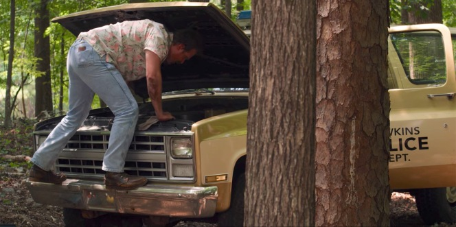 Despite the implications of his rough-and-ready work boots, Hopper isn't much of a mechanic and is forced to abandon his Blazer when it explodes in the woods.