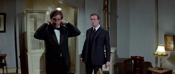 The Living Daylights providesa reversal of sorts of the iconic Goldfinger moment when Bond strips away his black tactical garb to reveal a white dinner jacket; Dalton's more serious Bond is the type who converts his fashionable evening wear into something more functional for the job.