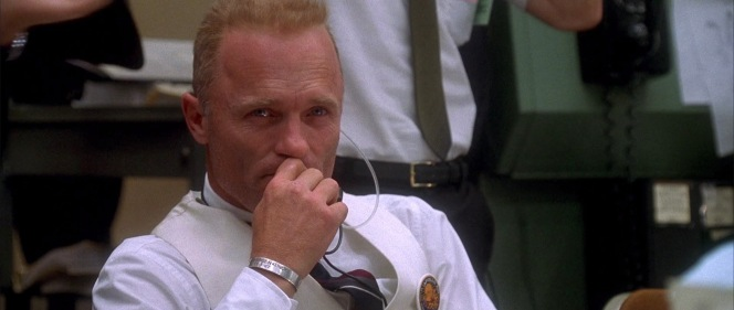 Ed Harris reportedly based Gene Kranz's quietly emotional reaction on how the real Kranz reacted when recalling his emotions at the time of the successful reentry. It's perhaps significant that this scene, celebrating the safe return of three American heroes presumed missing forever, provides the clearest shot of Kranz's POW/MIA bracelet honoring another missing American hero.